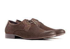 Pair of brown male shoes. On the white background Stock Photo