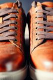 Pair of brown male shoes with laces as background close up, selective focus. Pair of brown casual male shoes with laces as background close up, selective focus Stock Images