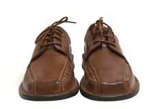 Pair of brown shoes isolated o. N white royalty free stock image