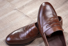 Pair of Brown Stylish Leather Penny Loafer Shoes Stock Images