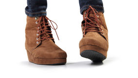 A pair of brown women boots in playful gesture Stock Photos