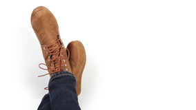 A pair of brown women boots relaxing Royalty Free Stock Images