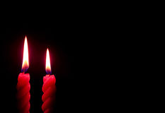 Pair of Burning Red Candles On the Dark Background Stock Photo