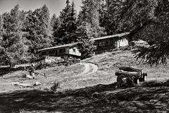 Pair of cabins on foothills in Italy Royalty Free Stock Images