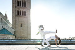 Pair of capoeira performers doing a kicking Royalty Free Stock Photo