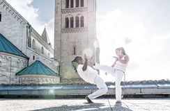Pair of capoeira performers doing a kicking Royalty Free Stock Image