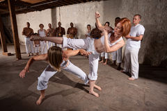Pair of Capoeria Performers Fighting Stock Photos