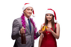 The pair celebrating christmas in the office isolated on white Royalty Free Stock Image