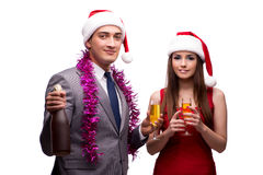 The pair celebrating christmas in the office isolated on white Royalty Free Stock Images