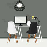 Pair of chair in empty working space with computer monitor and lamp Stock Image