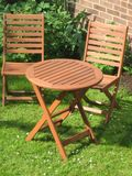 Pair of chairs. In the garden Royalty Free Stock Photos