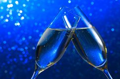Pair of a champagne flutes on blue light bokeh background Stock Photos