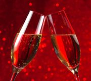 Pair of a champagne flutes on red light bokeh background Stock Image