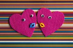 Pair of cheerful hearts. Stock Photos
