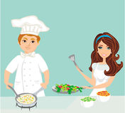 Pair of chefs prepares delicious dishes Royalty Free Stock Photos