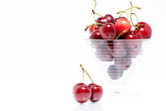 Pair of cherries and bowl Royalty Free Stock Photos