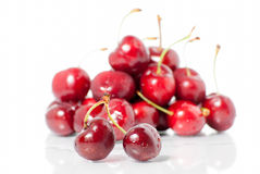 Pair of cherries and cherry pile Stock Images