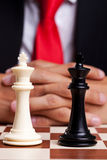 Pair of chess kings in front of businessman Royalty Free Stock Images
