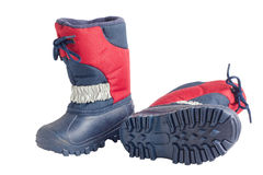 Pair of child's winter boots with rubber sole Stock Images