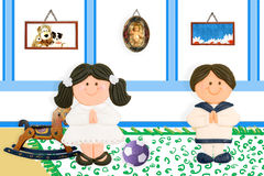 Pair of children first communion at home. Picture of child Jesus on the wall and old toys Stock Photos