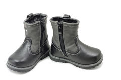 A pair of children`s winter boots. On a white background Stock Photo
