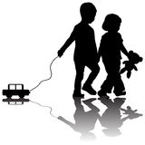 Pair of children with toy car Stock Photos