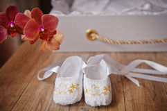 Pair of Childrens ballet shoes worn and flowers Royalty Free Stock Image