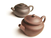 Pair of Chinese clay teapots. Chinese clay teapots with a traditional shapes Stock Image
