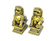 Chinese imperial lion statue isolated on white background Stock Images
