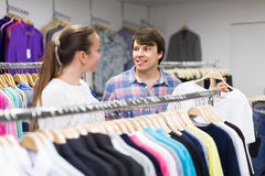 Pair chooses clothes at the store Stock Photography