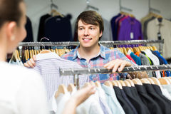 Pair chooses clothes at the store Stock Image