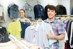 Pair chooses clothes at the store Royalty Free Stock Photo