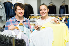 Pair chooses clothes at the store Stock Photo