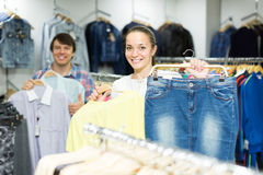 Pair chooses clothes at the store Stock Photos
