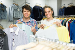 Pair chooses clothes at the store Royalty Free Stock Image