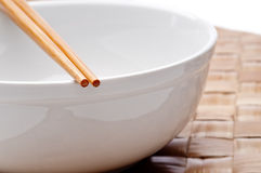 A pair of chopsticks on a white bowl Stock Photo