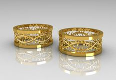 Pair of Christ's Crown Yellow Gold Wedding Bands Royalty Free Stock Images