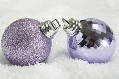 Pair of Christmas Baubles on Snow Stock Photography