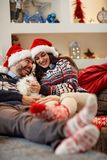 Pair in Christmas night enjoying in bad with their dog. Cheerful pair in Christmas night enjoying in bad with their dog Stock Image