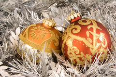 Pair of christmas ornaments and tinsel Stock Image