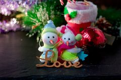 Pair of christmas snowmans with word Love near them. Pair of christmas snowmans with word Love near them Royalty Free Stock Image