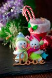 Pair of christmas snowmans with word Love near them. Pair of christmas snowmans with word Love near them Stock Images