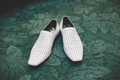 Pair of classic white leather male shoes. Closeup Royalty Free Stock Photo