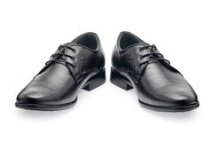 A pair of classical black leather shoes for men, with shoelaces. On a white background Stock Image
