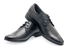 A pair of classical black leather shoes for men, with shoelaces Royalty Free Stock Photo