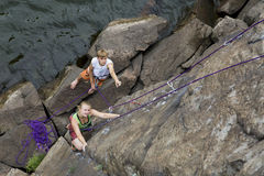 Pair of climbers starts an ascent Stock Photos
