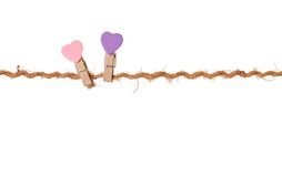 Pair clothespins with valentines  on rope Royalty Free Stock Photography
