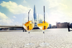 Pair of cocktail glasses - in the background the Thames and the Royalty Free Stock Photography