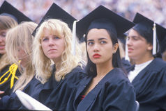 A pair of coeds watching their ceremony, Stock Photo