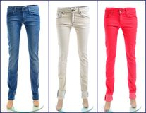 Pair of colored jeans. Color denim jeans in blue, white and red royalty free stock images